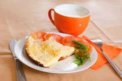 Breakfast with scrambled eggs and milk Royalty Free Stock Image