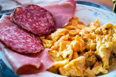 Breakfast with scrambled eggs and sausage.  Royalty Free Stock Images