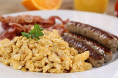 Breakfast with scrambled eggs, sausages and bacon Stock Photos