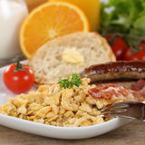 Breakfast with scrambled eggs, sausages and fruits Stock Image
