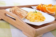 Breakfast with scrambled eggs, toasts, juice Royalty Free Stock Photography