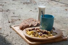 Breakfast with scrambled eggs, toasts, milk and coffee Stock Photo