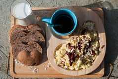 Breakfast with scrambled eggs, toasts, milk and coffee Stock Images