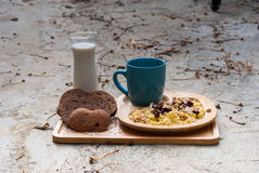 Breakfast with scrambled eggs, toasts, milk and coffee Royalty Free Stock Photo