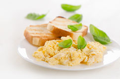 Breakfast with scrambled eggs and toasts. Selective focus Stock Photo