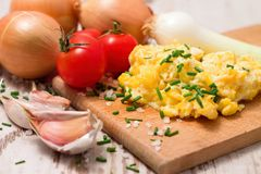 Breakfast with scrambled eggs and tomatoes Royalty Free Stock Photography