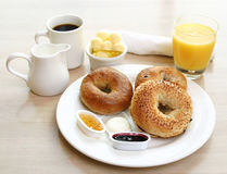 Breakfast Series - Bagels, coffee and juice. Classic breakfast of assorted bagels, toast, butter and orange juice stock photos