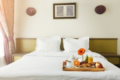 Breakfast served in bed on wooden tray Royalty Free Stock Image