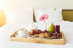 Breakfast served in bed on wooden tray Stock Photos
