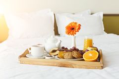 Breakfast served in bed on wooden tray Stock Images