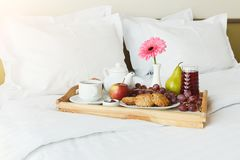 Breakfast served in bed on wooden tray Royalty Free Stock Photo