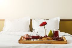 Breakfast served in bed on wooden tray Stock Photography