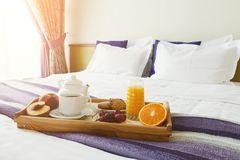Breakfast served in bed on wooden tray Royalty Free Stock Photography