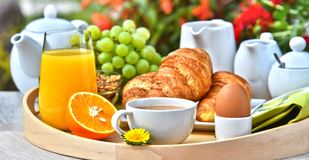 Breakfast served with coffee, juice, croissants and fruits Royalty Free Stock Images
