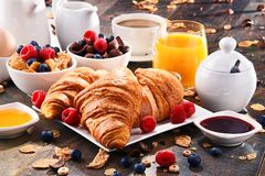 Breakfast served with coffee, juice, croissants and fruits. Breakfast served with coffee, orange juice, croissants, cereals and fruits. Balanced diet Stock Photo