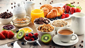 Breakfast served with coffee, juice, croissants and fruits Stock Images
