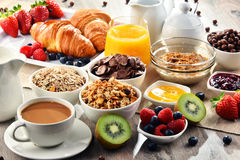 Breakfast served with coffee, juice, croissants and fruits Royalty Free Stock Photography