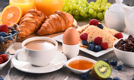 Breakfast served with coffee, juice, croissants and fruits. Breakfast served with coffee, orange juice, croissants, cereals and fruits. Balanced diet Stock Images