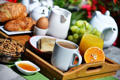 Breakfast served with coffee, juice, croissants and fruits Royalty Free Stock Image