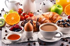 Breakfast served with coffee, juice, croissants and fruits stock photos