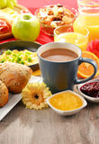 Breakfast served with coffee, juice, egg, and rolls Royalty Free Stock Photo