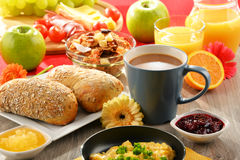 Breakfast served with coffee, juice, egg, and rolls Stock Images