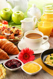 Breakfast served with coffee, juice, egg, and rolls Stock Image