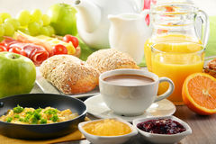 Breakfast served with coffee, juice, egg, and rolls Royalty Free Stock Images