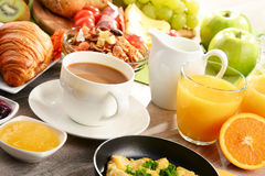 Breakfast served with coffee, juice, egg, and rolls. Breakfast served with coffee, orange juice, egg, rolls and honey. Balanced diet royalty free stock photo