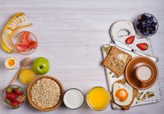 Breakfast served with coffee, orange juice, cereals, milk, fruits, eggs and toasts. Balanced diet, food banner, background Stock Photography