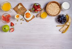 Breakfast served with coffee, orange juice, cereals, milk, fruits, eggs and toasts. Balanced diet, food banner, background Stock Photo