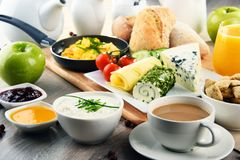 Breakfast served with coffee, cheese, cereals and scrambled eggs royalty free stock photo