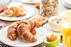 Breakfast served with coffee, orange juice and croissants stock photos