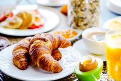 Breakfast served with coffee, orange juice, croissants, cereals and fruits. Balanced diet stock photography