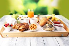 Breakfast served with coffee, orange juice, croissants and fruit stock images