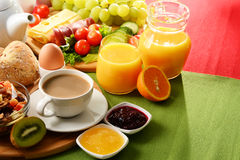 Breakfast served with coffee, orange juice, egg and fruits Royalty Free Stock Photos