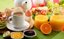 Breakfast served with coffee, orange juice, egg and fruits Stock Photos