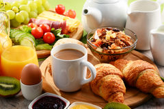 Breakfast served with coffee, orange juice, egg and fruits Stock Photo