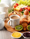 Breakfast served with coffee, orange juice, egg and fruits Royalty Free Stock Photography