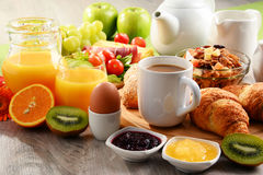 Breakfast served with coffee, orange juice, egg and fruits Royalty Free Stock Images