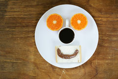 Breakfast serving funny face on the plate Royalty Free Stock Photo