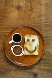 Breakfast serving funny face on the plate Royalty Free Stock Photos