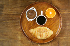 Breakfast serving funny face on the plate Royalty Free Stock Photography
