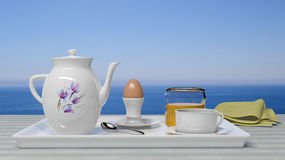 Breakfast set. In front of a beautiful seascape Royalty Free Stock Images