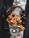 Breakfast set. Black baguette toasts with fresh Stock Photos