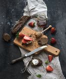 Breakfast set. Black baguette toasts with fresh Royalty Free Stock Images