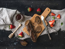 Breakfast set. Black baguette toasts with fresh strawberries, honey and mascarpone cheese Royalty Free Stock Image