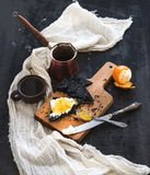 Breakfast set. Black bread toasts with tangerine Royalty Free Stock Photography