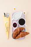 Breakfast set: black coffee, milk and a croissant with jam serve Stock Photo