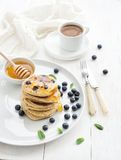 Breakfast set. Blueberry pancakes with fresh Stock Images